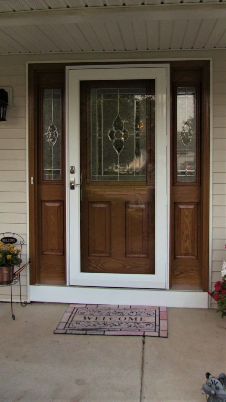 A beautiful new storm door to go along with the entry door and that amazing wooden and glass surround. We provide the highest quality here at Pinnacle Exteriors, and would love to give you a free assessment of your project... just call 484-350-6829 to get on the schedule  #exterior #exteriordesign #surround #stormdoor #styleinspiration #style #home #homesweethome #homeimprovement #entryway #entrywayideas #ideas #idea #door #doorway #doordesign #wood #beautiful #replacement…