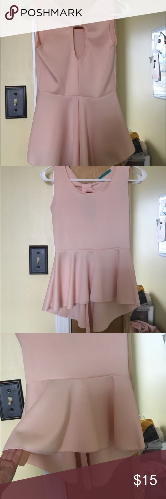 Semi-backless, hi-low, light pink peplum top 💕 Semi-backless, hi-low, light pink peplum top. Kinda looks like a bow in the back. Never worn. GREAT condition. Tops Tank Tops