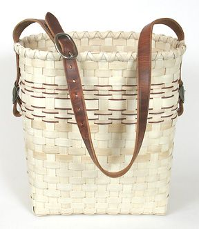 Mule Skinner Basket Pattern. Love the brown edging on the woven rows and the leather handle