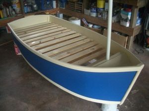 Single bed for the kids in the shape of a boat. Very easy to build and looks fantastic.