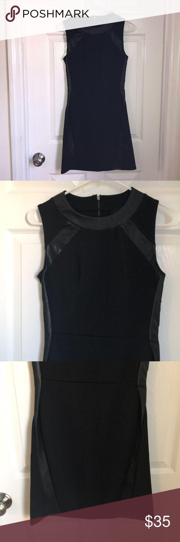 NWOT Aqua leather detail black dress Size small. Black aqua dress never worn with black leather details and zipper back Aqua Dresses
