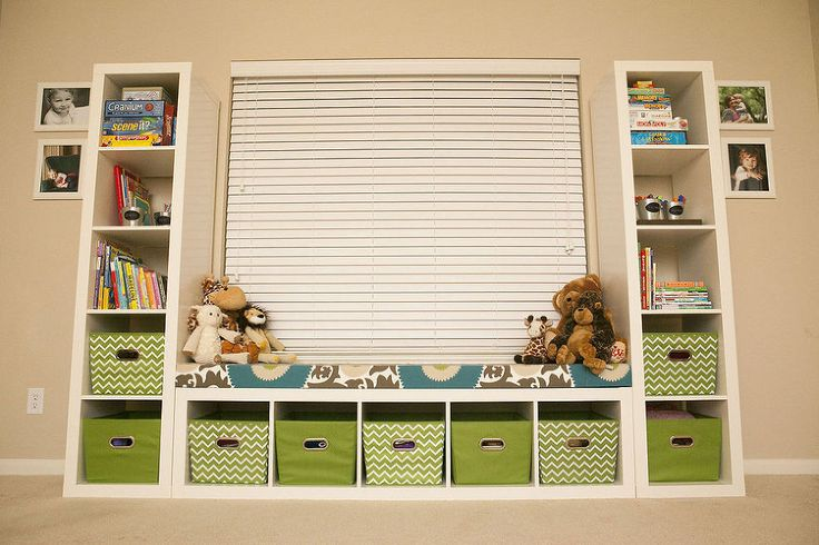 Kid Toy Storage - Using three Ikea Expedit shelves to frame a window in the playroom allows for optimal storage and easy access to the toys. P…