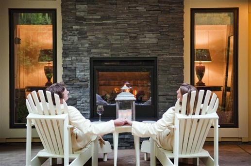 Guests enjoying the indoor-outdoor fireplace on the patio of one of the Barn Rooms at The Farmhouse Inn - Forestville, CA