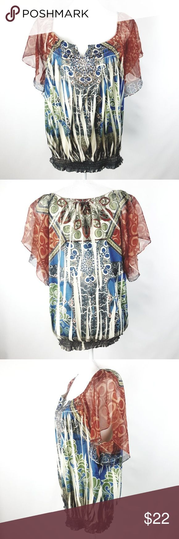 """Cato Sublimation Popover Flutter Sleeve Top 18 20W Size 18W 20W Great Condition! No rips, stains, etc.  Multi-Colored Sheer Flutter Sleeves Popover Lightweight, Soft, Stretch Stretch Elastic Bottom   Career or Casual  Measurements taken un-stretched & laying flat: Armpit to Armpit: 24"""" Length: 26.5""""  Check out my other listings! Cato Tops Blouses"""