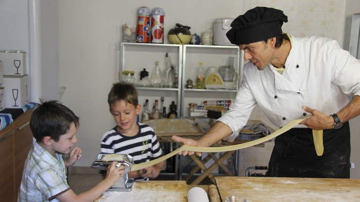 Junior foodies: Fabrizio teaches Kate Farrelly's sons, Patrick and Braden, how to make spaghetti.IMG_2011-001_small.jpg