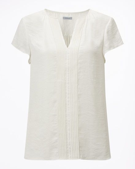 Made from wrinkle resistant fabric with silk trims, this top is a feminine addition to your spring summer wardrobe. Lightweight, it has a contrast front, centre panel and V-neckline. A beautiful drape, wear with tailored trousers or jeans.