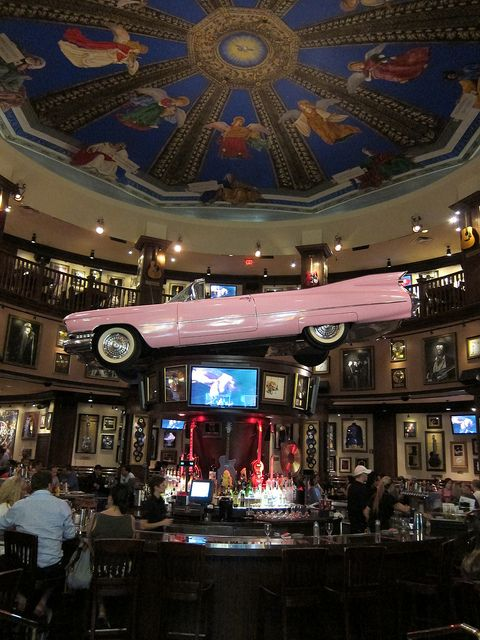 The convertible pink Cadillac rotates above the bar at the Hard Rock Cafe in Orlando, Florida