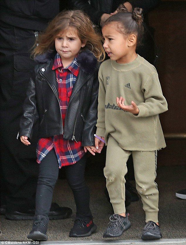Holding on tight: On Sunday, cousins North West and Penelope Disick once again proved their tight friendship as they strutted along while deep in chat during a family outing in their native Calabasas