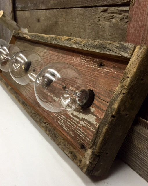 A personal favorite from my Etsy shop https://www.etsy.com/listing/230317557/4-bulb-barnwood-rustic-vanity-light