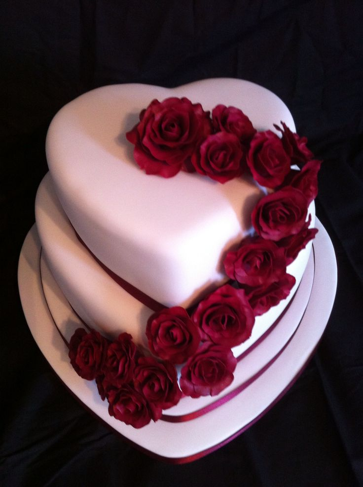 Heart shaped wedding cake with hand made roses