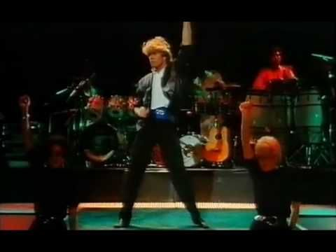 Wham! Everything she wants Live in China 1984 Remastered  (I also have the 90's live performance on MTV Unplugged).  Both good and representative of their respective times.