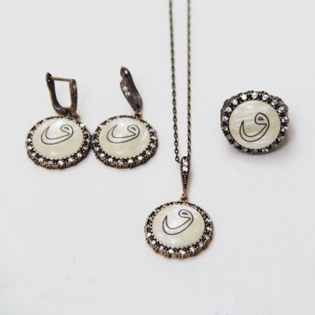 Mother of Pearl Set Arabic letter waw is laser engraved on Mother of Pearl Pendant and earrings are set in a bronze tray and framed with zirconia stones Ring is adjustable Chain size : 45 cm  FREE SHIPPING