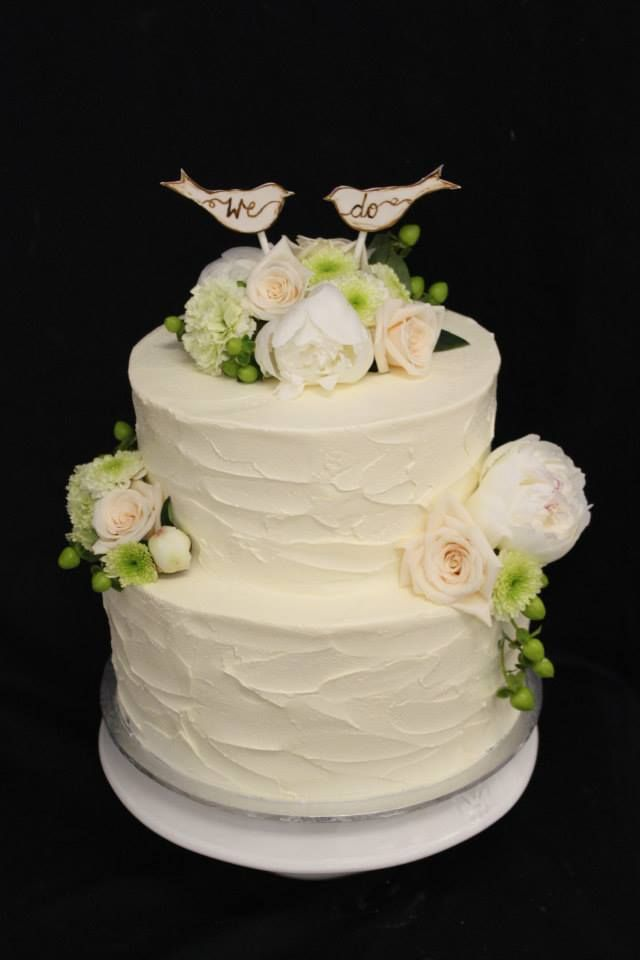 Gorgeous two tier with stucco finish and bird toppers