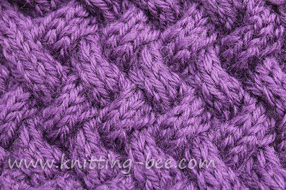 Medium sized diagonal basketweave cable knitting stitch pattern.