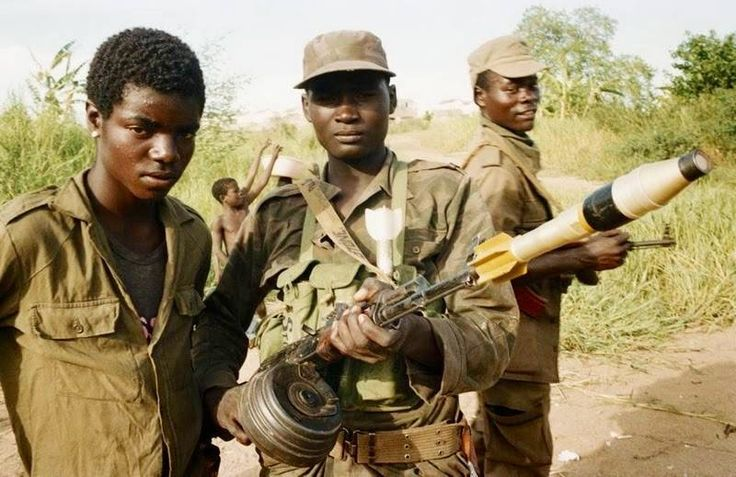 Angolan soldiers in the field sometime during 1987. Note the use of drum magazines on assault rifles and rifle-launched grenades.