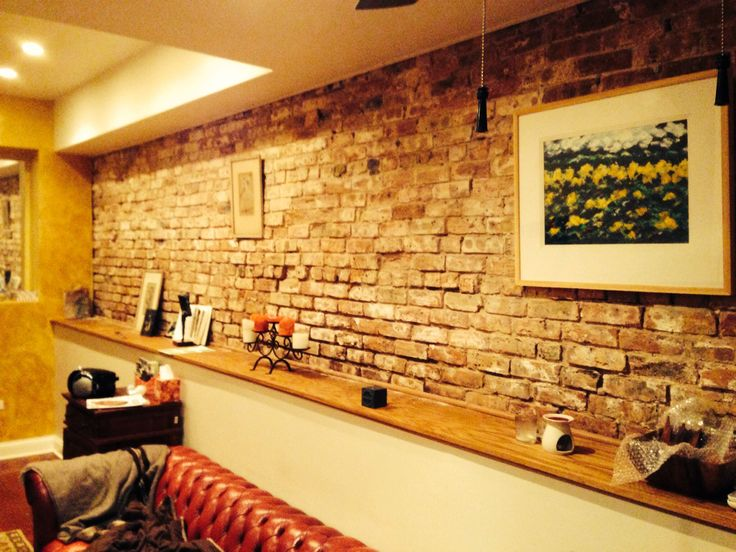 Brick wall with half a shelf wall built in