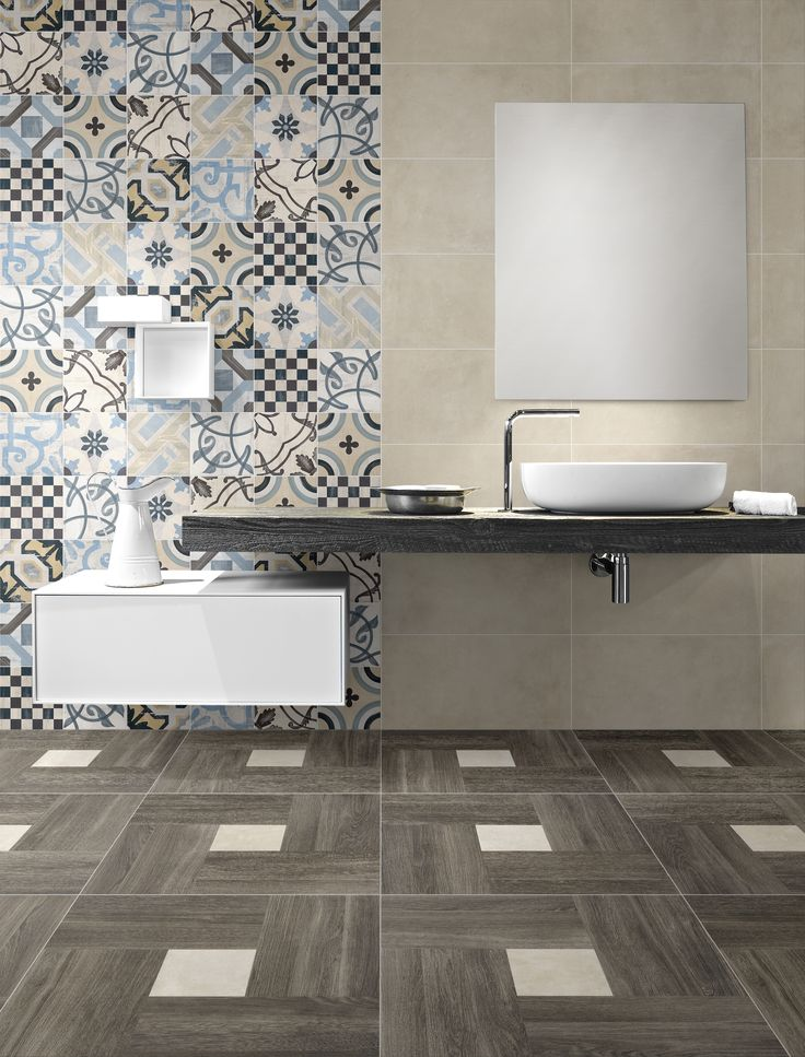 """Inside features inserts in solid colours and decorated in module 50, while in the version of 60 the Blend collection by Fioranese in Grigio, Avorio, Sabbia and Oliva matches the interiors, making it possible to combine different materials. The series is accompanied by decorated base tiles that can be used on Floors and Walls to complement the originality of Inside giving it a """"Vintage"""" touch. Tile on photo - Fioranese Inside 60 BrownSabbia  + BlendSabbia 30x60 + Cementine Mix."""