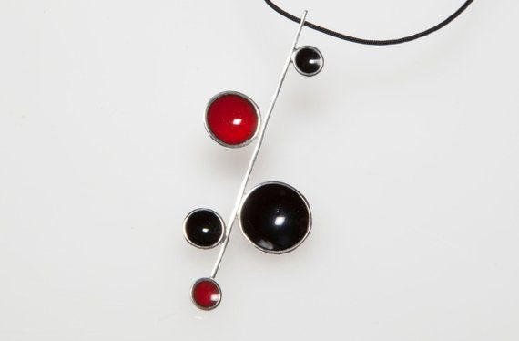 CONTEMPORARY SILVER AND RED ENAMEL PENDANT ON WIRE STRANDS NECKLACE