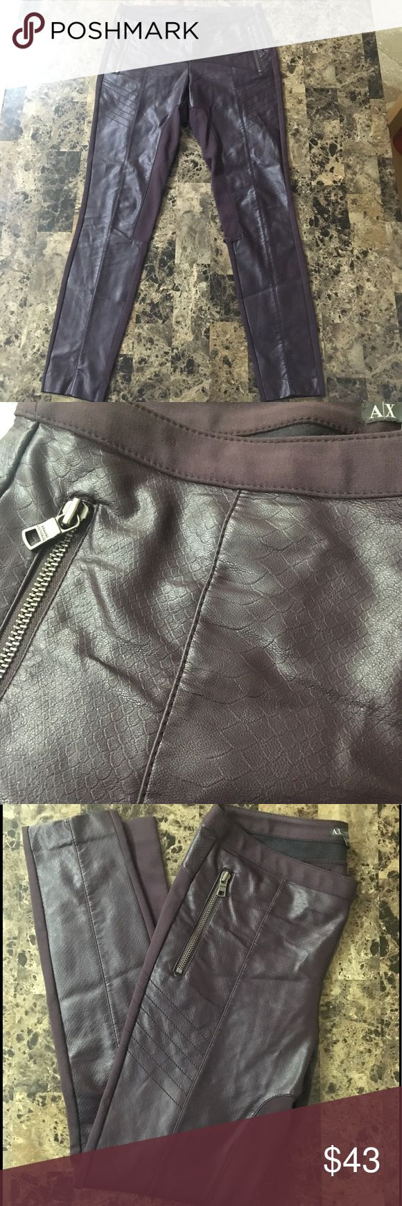 Armani Exchange stunning leather pants/leggings Armani Exchange stunning leather pants, Stretchy leggings. Dark plum/maroon in color. Zippered pockets give these pants a cool edge! EUC condition, no issues! Thanks! Armani Exchange Pants Leggings