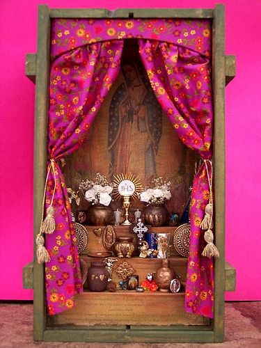 Miniature La Virgen de Guadalupe Altar, with hot pink satin fabric as both frame and entrance to a shadowbox.