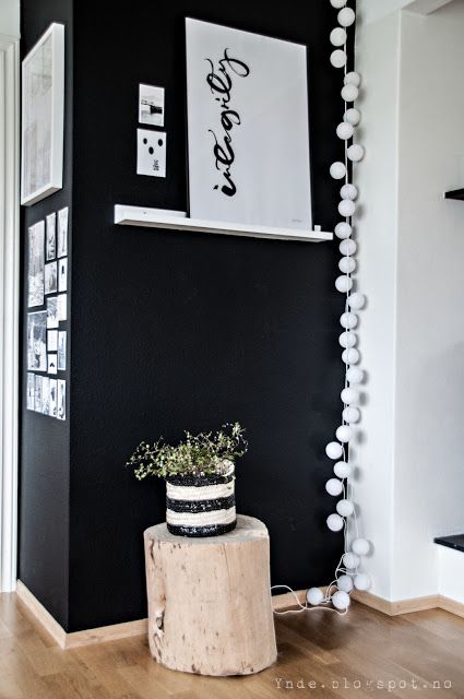 Lovely #home details! Love the black wall with happy lights in the corner!