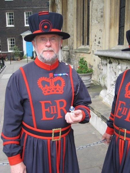 At the Tower of London in 2008.  This Yeoman Warder (aka, Beefeater) obliged me with this pic, but he didn't love it!