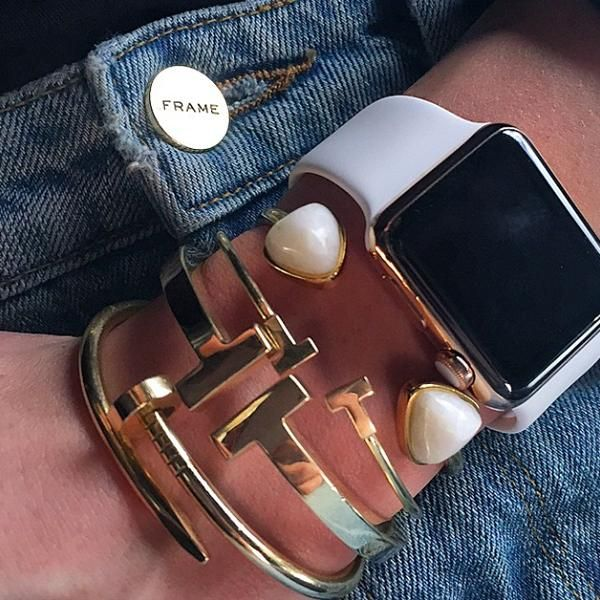 Fashion Insiders and Celebrities With the Apple Watch - model Karlie Kloss wearing frame denim, gold arm candy, and a white Apple watch