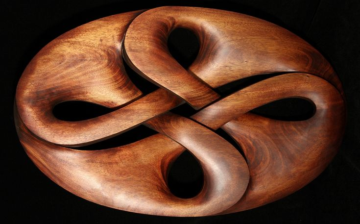 Work by Boris Kopilevich.  http://boriska2009.wix.com/wood-and-metal