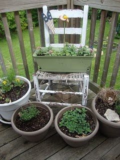 Potted Herb Garden with a rustic chair gives of old charm and provides a focal centerpiece.