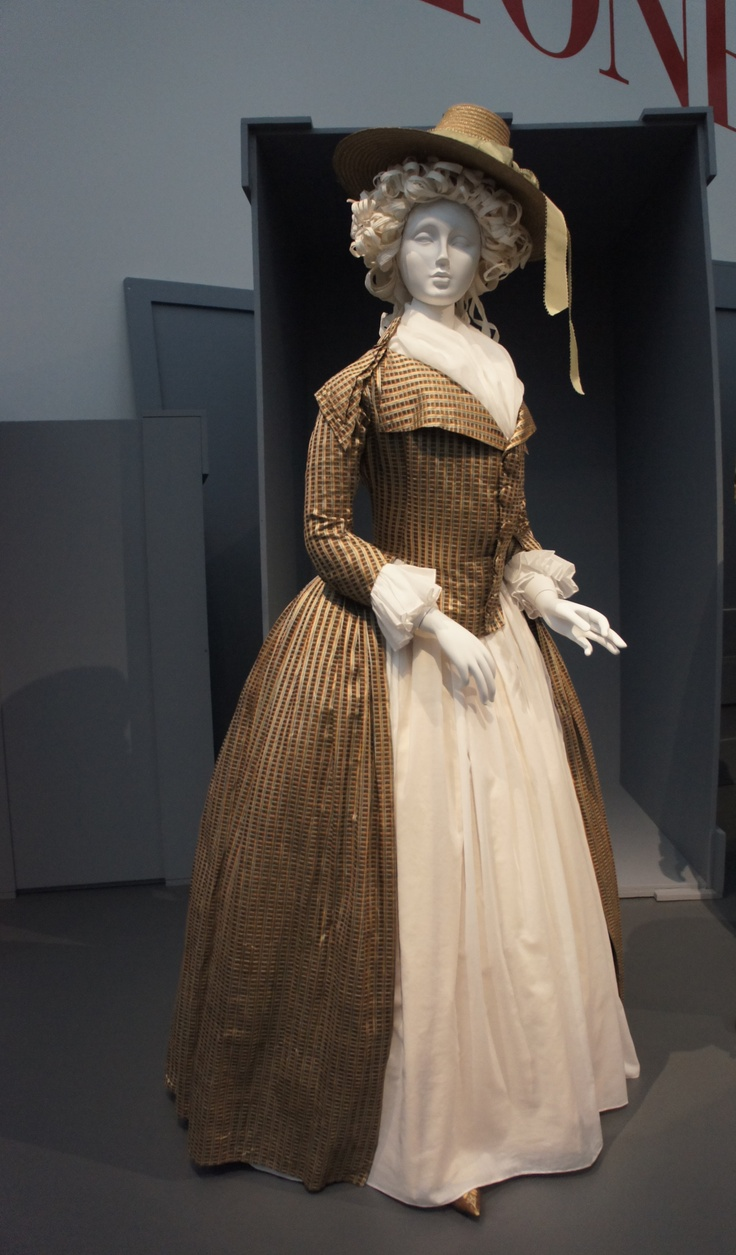 Redingote, Europe, c. 1790, silk and cotton satin and plain weave. Fichu, England, 1780-95, cotton plain weave (muslin) with cotton embroidery (LACMA)