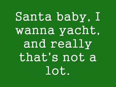 'Santa Baby' - Eartha Kitt--- ( she also was cat woman in Batman and the voice for Kronk's girlfriend {Yzma} in Emperors new groove)     :)