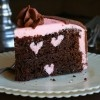 Chocolate Cake with Three Raspberry Buttercream Heart Carved Inside