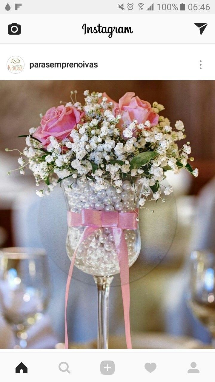 pretty baby's breath and roses in pearl-filled goblets, party table decorations