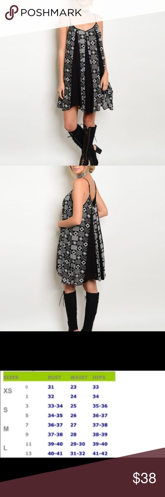 🆕 Black & White Tribal Dress Nice Boho chic piece to have for festival. Black & white tribal dress is a perfect add to the boho wardrobe. Material:  100% rayon.  Price is firm unless bundled.  😊 Dresses