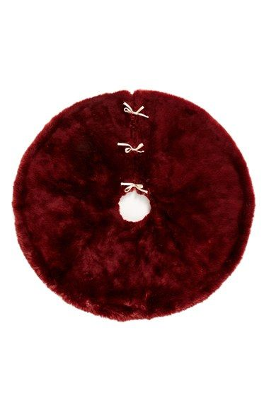 Step up your Christmas tree game with this fabulous faux fur tree skirt!