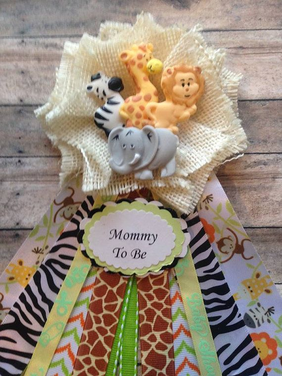 Safari Jungle Animals Theme Mommy To Be Corsage  Baby Shower Corsage Measures: 3 1/2 x 7  Handmade from White Burlap decorated with Ribbon and PolyClay Adorable Zebra, Giraffe, Elephant and Lion.  Ship Via USPS First Class. Please allow 3-5 Business Days for processing and for shipping  A Pin is attached on the back  Thank You For Your Visit To The Shop