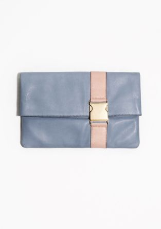 A contemporary fusion of chic and sporty details comes to form this leather foldover clutch with a contrasting strap and a chunky side release buckle.