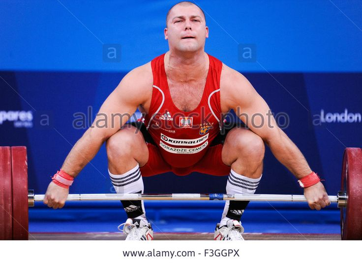 Download this stock image: Bartlomiej BONK (POL) in the snatch, The London Prepares Weightlifting Olympic Test Event, ExCel Arena, London, England December - F3GGPX from Alamy's library of millions of high resolution stock photos, illustrations and vectors.