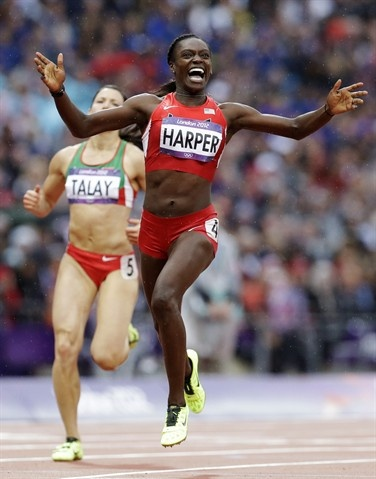 Day 11: Evening Session - Track & Field Slideshows | United States' Dawn Harper reacts as she crosses the finish line in a women's 100-meter hurdles semifinal.  (Photo: Lee Jin-man / Assocaited Press) #NBCOlympics