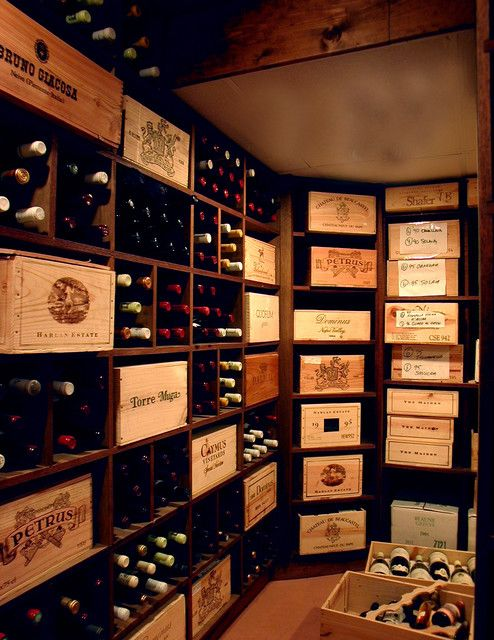 I love how they used the combo of wine bottles and wine crates to decorate the…