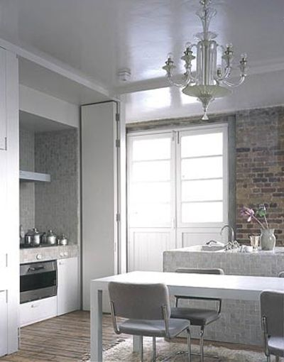 Ilse Crawford London loft kitchen, white, marble, chandelier London apartment Pinterest