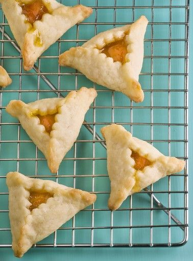 GRANDMA'S HAMANTASCHEN 2 cups flour 3 T sugar 2 sticks (1 cup) unsalted butter, cubed 8 ounces cream cheese, cut into chunks 3/4 cup apricot filling (3 cups water, 1/2 cup sugar, 1/2 pound dried apricots, the juice of 1 lemon and 1 split and scraped vanilla pod, cooked for 90 min) or apricot jam; 350*, 15 min.