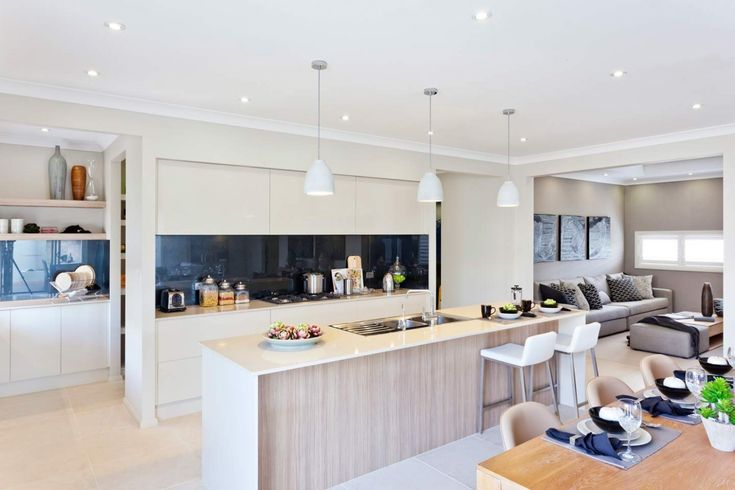 Beautiful pendant lighting over this big Gourmet Kitchen in the Sandalford design by McDonald Jones Homes. Exclusive to Canberra. On display at 6 Bonarba Link, Googong NSW 2620. #kitchen #gourmetkitchen #lighting #mcdonaldjones #Canberra #ACT