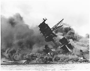 Picture of the USS Arizona burning after the attack on Pearl Harbor on December 7, 1941. - (Picture courtesy of the National Archives and Records Administration)