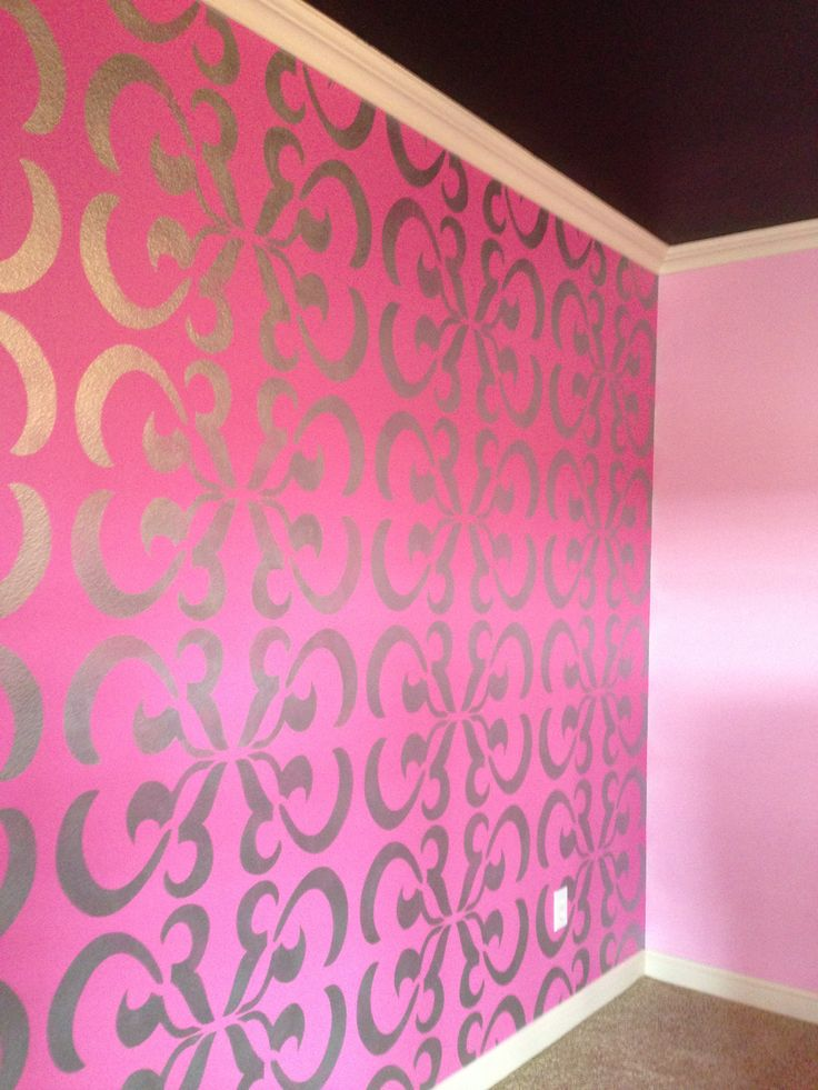 """The perfect tween bedroom! Our clients wanted something special to grow with their daughter and they were willing to go """"out of the box"""". Our design plan... jet black ceilings, soft pink walls, a bright pink accent wall with a custom designed stencil from """"A Work of Art!"""" in bright silver. #AWorkOfArt #Design7Seven #customstencildesign"""