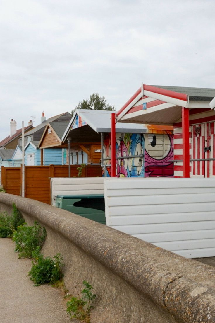 Beach huts on Whitstable beach, Kent Coast, UK. A lovely place to walk and get some sea air! | The Travel Journo