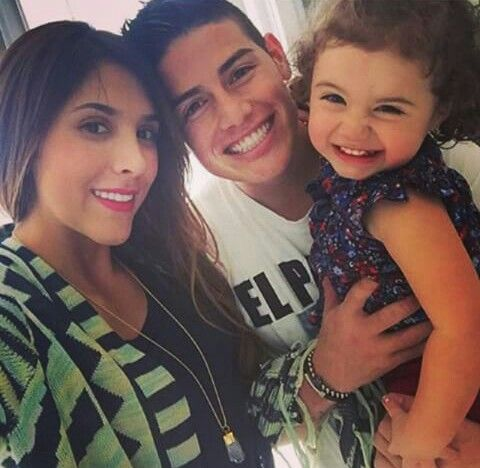 James with his wife and kid