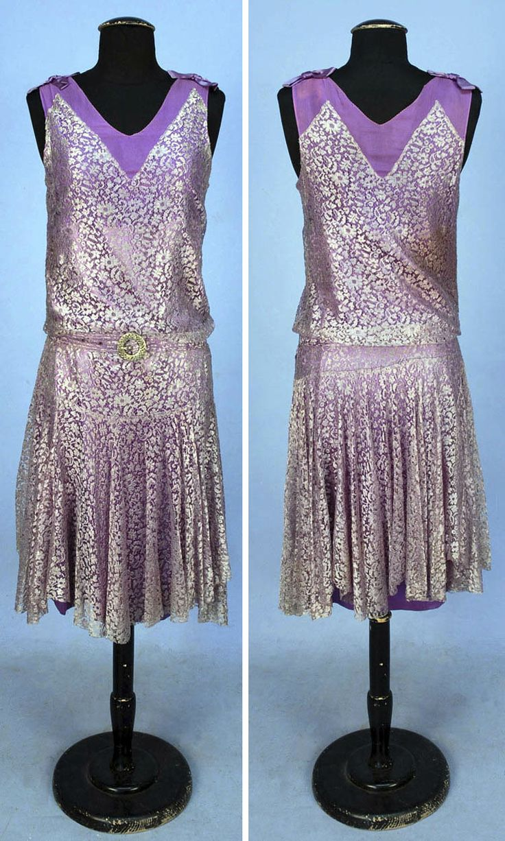 1920s sleeveless lavender lace over lilac chiffon bodice and satin underskirt dress. Shoulders decorated with satin bows. Self belt with jeweled buckle. Via Whitaker Auctions.