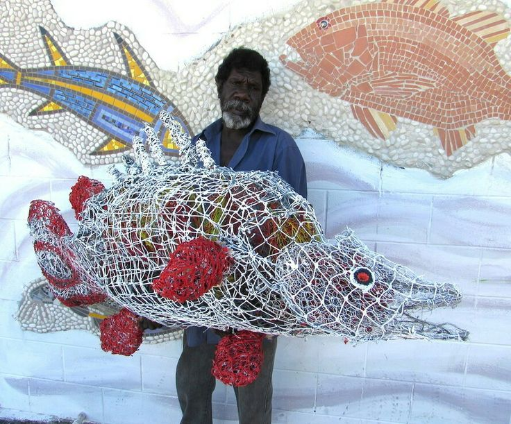 "Pormpuraaw Artist Michael Norman displays his ghost Net Sculpture of a ""Cod"". Our art is a bridge between our culture, community and the outside world. Pormpuraaw means ""entrance way to a house"" in Kuuk Thaayorre language. We are an aboriginal community strong in language and culture. It is a beautiful place surrounded by wetlands next to the sea of Carpentaria on the Cape York Peninsula Queensland Australia. The Centre is dedicated to assisting community artist and cultural maintenance."