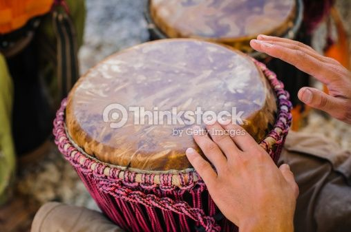 Stock Photo : Man playing the djembe